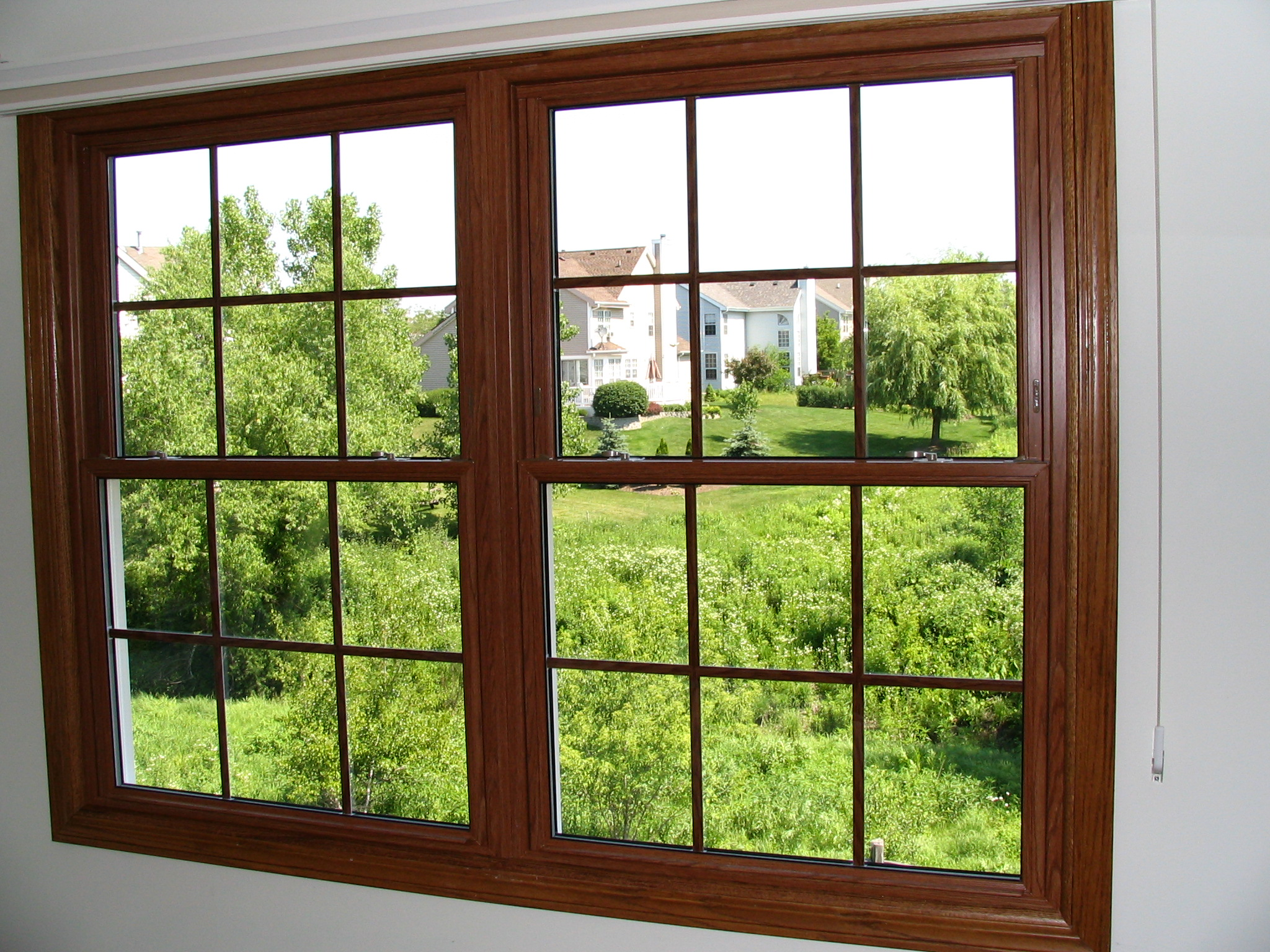 Provincial oak vinyl double hung windows custom built for Double hung window